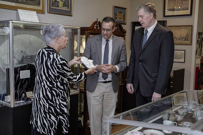 Jackie Bolden (left), director of the World Methodist Museum, shows the John Wesley death mask to Anthony Elia (center), director of Bridwell Library at Perkins School of Theology, and the Rev. Craig C. Hill, dean of the Perkins School of Theology, during the final meeting of the Friends of the World Methodist Museum in Lake Junaluska, N.C. Photo by Ryan Hipps.